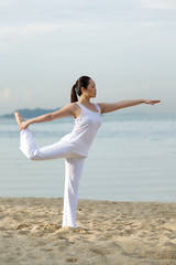Asian woman standing doing yoga