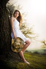 fairy princess in white dress in the garden