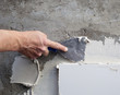 construction spatula trowel in tile work with mortar