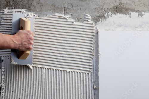 construction notched trowel with white cement Poster