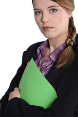 Young businesswoman with file.