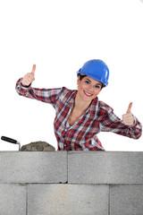 A female mason with both thumbs u.