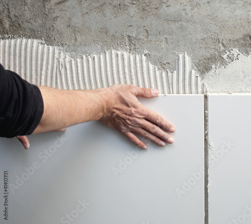 construction mason man hands on tiles work