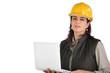 Female architect holding laptop computer