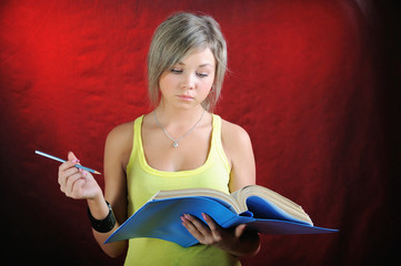 The girl reads documents.