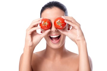 Healthy woman with tomatos over eyes