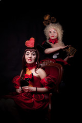 queens of hearts and clubs