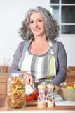 Fototapety mature woman cooking