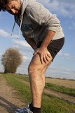 Man having cramp while running