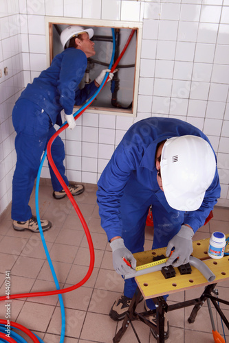 Workers  repairing pipes