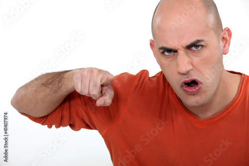 Angry man pointing his finger