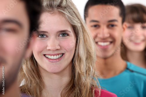 A row of young and smiley people