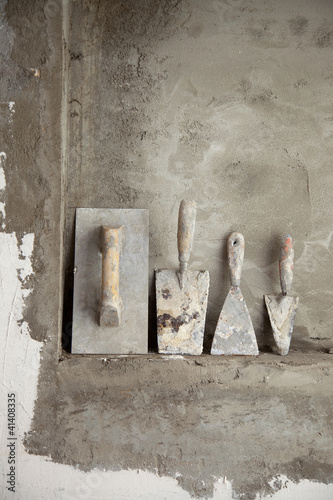 Poster aged construction cement mortar used tools