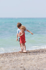 two children on sea background