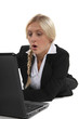 Woman surprised in front of laptop