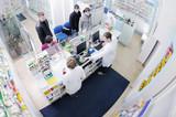 pharmacist suggesting medical drug to buyer in pharmacy