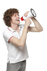 Happy man making announcement over megaphone