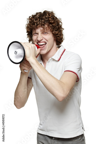 Young man yelling into the megaphone, over white