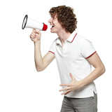 Side view of young man yelling into the megaphone