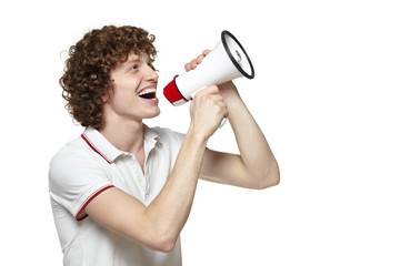 Happy man making announcement over a megaphone