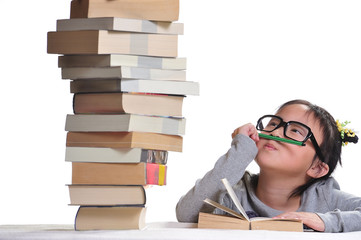 A girl looking at a pile of books