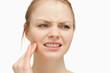 Woman massaging her cheek
