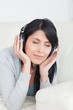 Woman closing her eyes with headphones on