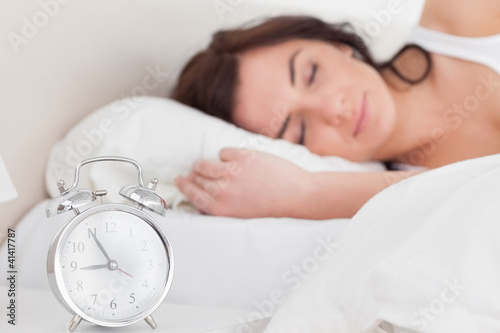 Brunette woman sleeping in the morning