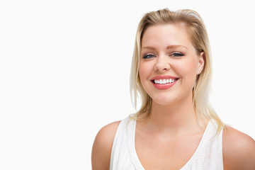 Cheerful blonde woman standing upright