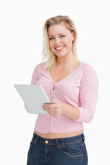 Smiling woman holding her tablet computer