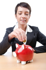 Woman and piggybank on white
