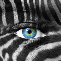 Human face with Zebra pattern - Save endangered species concept