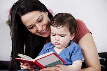 A mother and her baby son reading a book