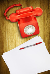 red phone and paper