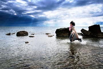 Free girl running in the sea