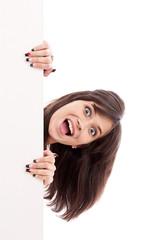 Girl surprised looking at white billboard
