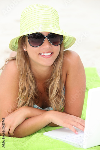 Teen with hat on the beach