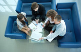 Top view of working business group sitting at table
