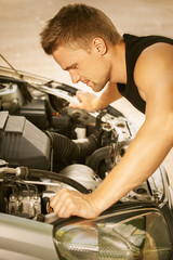 young man repairing car
