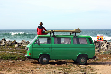 Surfer with his retro van