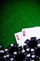 Poker hand with chips, Pocket Aces