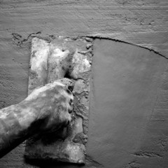 trowel with glove hand plastering cement mortar