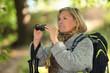 Woman with rucksack and binoculars
