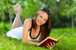 Beautiful Young woman reading a book in park