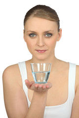 young beautiful blonde handing out glass of water