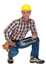 Tradesman holding a tube bender
