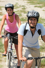 Couple enjoying leisurely bike ride