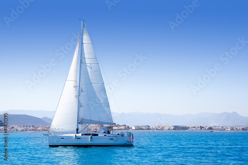 sailboat sailing in Mediterranean sea in Denia