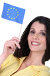 Woman holding a European Union flag