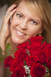 Smiling Blonde Woman with Red Roses
